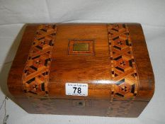 A Victorian mahogany inlaid sewing box in good condition.