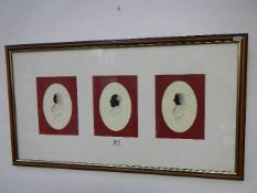 A framed and glazed Jeff Grey Tryptich of watercolour silhouette portraits of the music composers