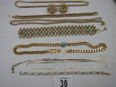 A mixed lot of gold coloured pendants (8 items).