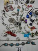 A mixed lot of costume jewellery including earrings, rings etc., some silver.
