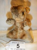 A small Steiff beaver with button in ear and glass eyes.