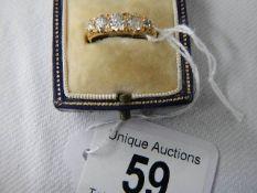 An 18ct five stone diamond ring,