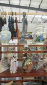 A mixed lot of oriental figures, lidded urns, vases etc., (8 items).