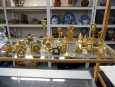 A good collection of miniature clocks, mainly brass, 1 Border Fine Arts,