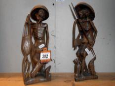 2 carved wooden oriental figures
