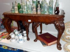 A carved darkwood stained glass top long nest of tables