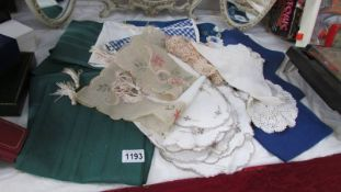A small collection of napkins, doilies, dressing table mats etc.