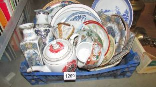 A mixed lot of oriental style ceramics including plates, vases etc.