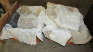2 wicker baskets of vintage linen including table cloths, doilies etc.