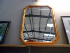 A pine framed mirror,
