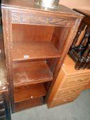 An oak bookcase, height 127cm, width 49.5cm approx.