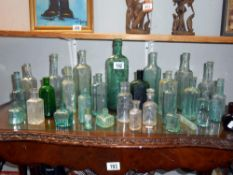 A quantity of antique glass bottles