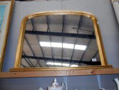 An antiqued finished gilt framed overmantle mirror size;