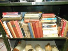 A shelf full of books on many subjects (annuals,