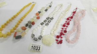 6 assorted stone necklaces in various colours.