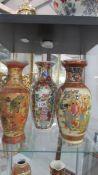 Three large Chinese vases.