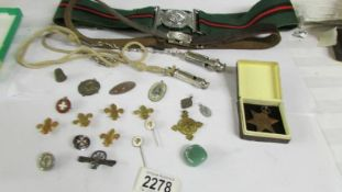A Yorkshire Regiment belt, a girl guides belt, 2 whistles and various medals and badges.