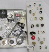 A good lot of vintage rings together with a tray of fashion jewellery.