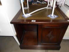 A leather topped darkwood stained bookcase, height 51.5cm, width 61cm approx.