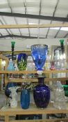 A large mixed lot of art glass including vases, Toby Jug etc.