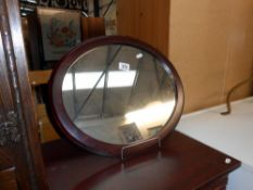 A modern oval mahogany framed mirror, size 50cm x 43cm approx.