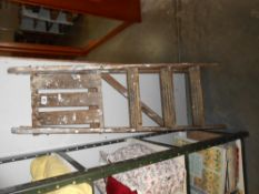 A small wooden step ladder,