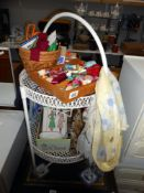 A vintage plastic coated wine/bottle stand, height 87cm and a quantity of vintage sewing items,