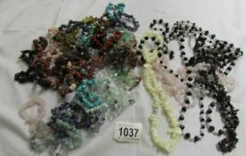 A mixed lot of assorted chip necklaces and bracelets,.