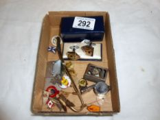A collection of pin badges, playing cards, cufflinks etc.