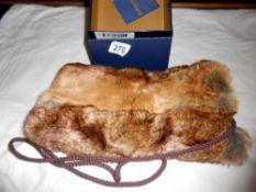 A Dubarry faux fur muff in original box