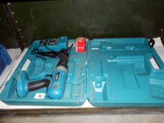 A Cased Makita power drill with charger