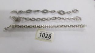 Three silver bracelets.