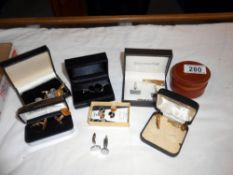 A quantity of cufflinks including a silver set plus a tie pin