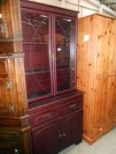 A darkwood stained glazed top dresser/display cabinet with cupboard/drawer base, height 187.