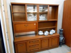 A modern wall unit with glass and drinks cabinet, height 183cm,