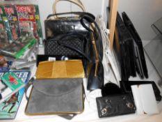 A mixed lot of ladies handbags, satchels etc.