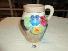 A Clarice Cliff Bizarre jug 'Pansies' minor ware to paint on rim, but hardly noticeable,