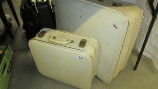 2 vintage suitcases.