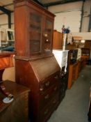 A 1920'30's oak bureau bookcase (lock and escutcheon in drawer and needs to be fixed back on),