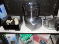 A Cuisinart food processor and a Cuisinart accessories box