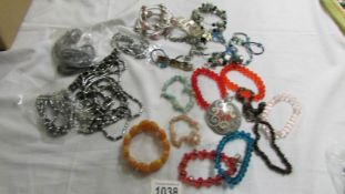 A grey necklace, bracelet and earrings,