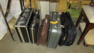 A quantity of briefcases, suit case, hard case etc.