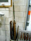 A quantity of vintage fishing rods etc.