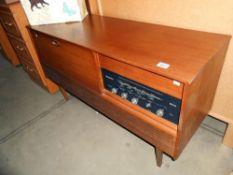 A retro teak effect Westminster record player radio radiogramme, height 66cm, length 117cm approx.