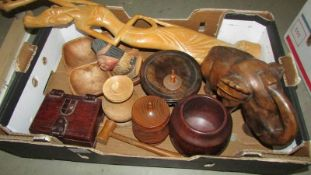 A large box of mixed wooden items including wood turnings, elephant etc.