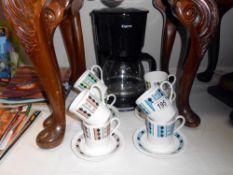 8 Ridgeway Masquerade bone china coffee cups and saucers along with a coffee perculator