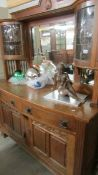 A good quality oak mirror backed sideboard with top side cabinets.