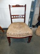 A Victorian nursing chair on casters