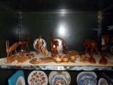 A good selection of treen and carved wooden items including elephant, antelope etc.
