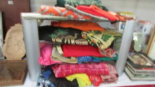 A good lot of Sari's, Egyptian themed clothing including dresses, scarves etc.